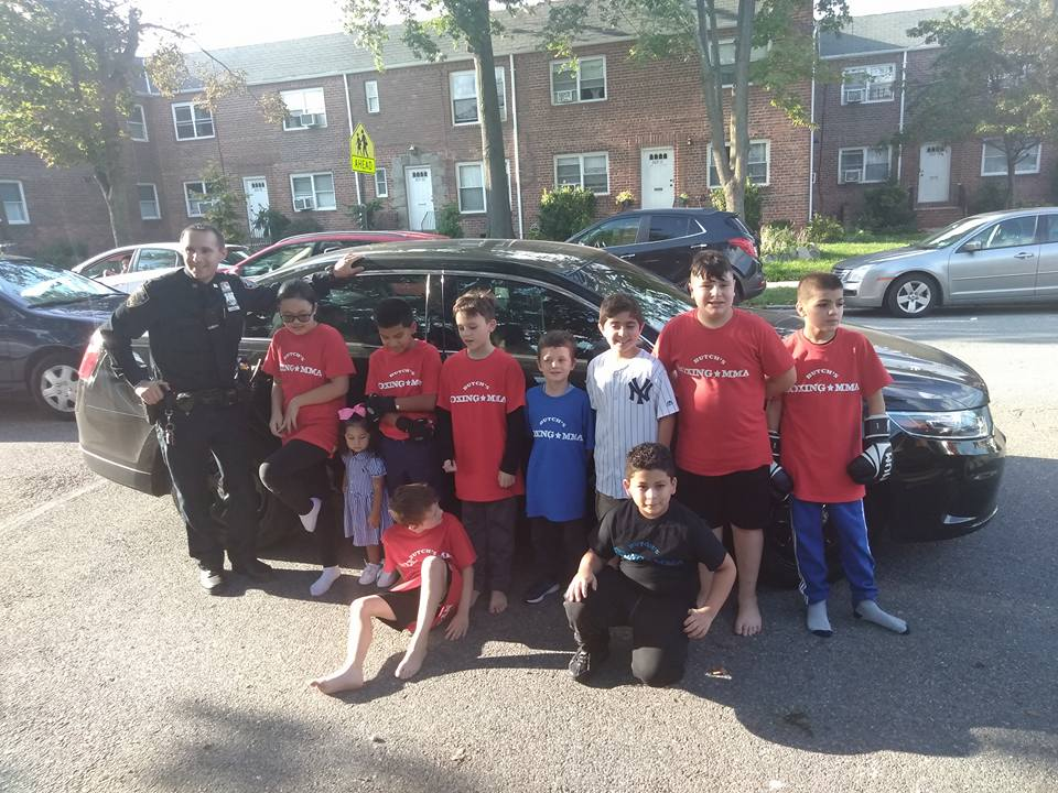Kids posing with NYPD 111 pct. Thank you 111 pct.