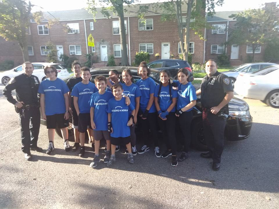 Teens posing with NYPD 111 pct. Thank you 111 pct.